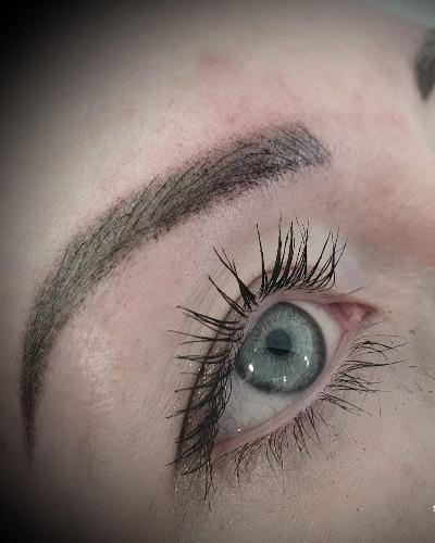 Close up showing combination semi permanent eyebrow makeup