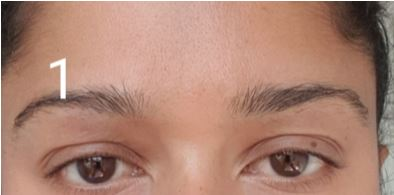 How to shape your eyebrows - clean the brow area.