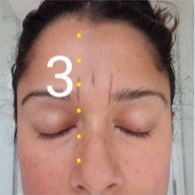 How to shape your eyebrows - use a ruler to mark the start of your brows.