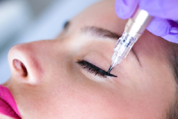Woman having semi permanent eyebrow treatment